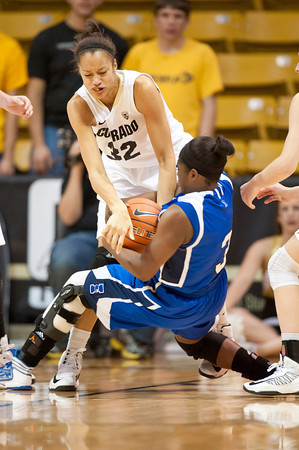 S1124CUBASKET9<br /> CU's #32, Arielle Roberson, fights Texas A&M's #3, Ashley Darley, for a loose ball during CU's 75-48 win at the Coors Event Center in Boulder Colorado on Friday evening, November 23rd, 2012.<br /> <br /> Photo by: Jonathan Castner