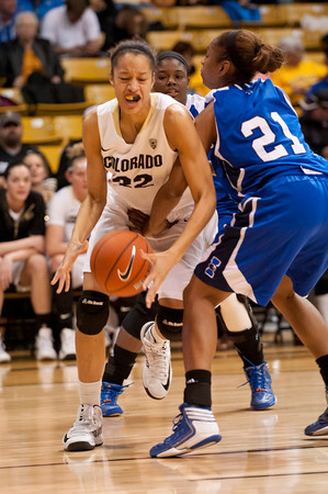 S1124CUBASKET6<br /> CU's #32, Arielle Roberson, is fouled under the boards by Texas A&M's #21, Jessica Jammer during CU's 75-48 win at the Coors Event Center in Boulder Colorado on Friday evening, November 23rd, 2012.<br /> <br /> Photo by: Jonathan Castner