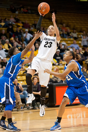 S1124CUBASKET12<br /> CU's #23, Chuckie Jeffery, puts one up and in as Texas A&M's #21, Jessica Jammer and #10, Janae Blount defend during CU's 75-48 win at the Coors Event Center in Boulder Colorado on Friday evening, November 23rd, 2012.<br /> <br /> Photo by: Jonathan Castner