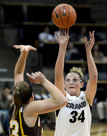 "University of Colorado's Jen Reese takes a shot over Ashley Sickles during a game against the University of Wyoming on Wednesday, Nov. 28, at the Coors Event Center on the CU campus in Boulder. For more photos of the game go to  <a href=""http://www.dailycamera.com"">http://www.dailycamera.com</a><br /> Jeremy Papasso/ Camera"