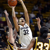 "University of Colorado's Arielle Roberson takes a shot over Kaitlyn Mileto, left, and Chaundra Sewell, No. 33, during a game against the University of Wyoming on Wednesday, Nov. 28, at the Coors Event Center on the CU campus in Boulder. For more photos of the game go to  <a href=""http://www.dailycamera.com"">http://www.dailycamera.com</a><br /> Jeremy Papasso/ Camera"