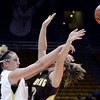 "University of Colorado's Jen Reese passes the ball over Alison Gorrell during a game against the University of Wyoming on Wednesday, Nov. 28, at the Coors Event Center on the CU campus in Boulder. For more photos of the game go to  <a href=""http://www.dailycamera.com"">http://www.dailycamera.com</a><br /> Jeremy Papasso/ Camera"