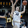 """University of Colorado's Rachel Hargis takes a shot over Ashley Sickles during a game against the University of Wyoming on Wednesday, Nov. 28, at the Coors Event Center on the CU campus in Boulder. For more photos of the game go to  <a href=""""http://www.dailycamera.com"""">http://www.dailycamera.com</a><br /> Jeremy Papasso/ Camera"""