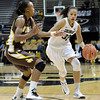 "University of Colorado's Arielle Roberson drives past Chaudra Sewell during a game against the University of Wyoming on Wednesday, Nov. 28, at the Coors Event Center on the CU campus in Boulder. For more photos of the game go to  <a href=""http://www.dailycamera.com"">http://www.dailycamera.com</a><br /> Jeremy Papasso/ Camera"