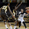 "University of Colorado's Chucky Jeffery drives toward the hoop in front of Chaundra Sewell, No. 33, during a game against the University of Wyoming on Wednesday, Nov. 28, at the Coors Event Center on the CU campus in Boulder. For more photos of the game go to  <a href=""http://www.dailycamera.com"">http://www.dailycamera.com</a><br /> Jeremy Papasso/ Camera"