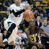 "University of Colorado's Chucky Jeffery gets the ball knocked out of her hands by Chelan Landry during a game against the University of Wyoming on Wednesday, Nov. 28, at the Coors Event Center on the CU campus in Boulder. For more photos of the game go to  <a href=""http://www.dailycamera.com"">http://www.dailycamera.com</a><br /> Jeremy Papasso/ Camera"