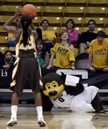 "University of Colorado mascot ""Chip"" holds a "" your cute "" sign while trying to distract Chelan Landry's free-throw during a game against the University of Wyoming on Wednesday, Nov. 28, at the Coors Event Center on the CU campus in Boulder. For more photos of the game go to  <a href=""http://www.dailycamera.com"">http://www.dailycamera.com</a><br /> Jeremy Papasso/ Camera"