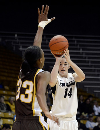 "University of Colorado's Meagan Malcolm-Peck takes a shot over Chaundra Sewell during a game against the University of Wyoming on Wednesday, Nov. 28, at the Coors Event Center on the CU campus in Boulder. For more photos of the game go to  <a href=""http://www.dailycamera.com"">http://www.dailycamera.com</a><br /> Jeremy Papasso/ Camera"