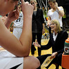 "University of Colorado Head Coach Linda Lappe, right, talks with her team during a time-out against the University of Wyoming on Wednesday, Nov. 28, at the Coors Event Center on the CU campus in Boulder. For more photos of the game go to  <a href=""http://www.dailycamera.com"">http://www.dailycamera.com</a><br /> Jeremy Papasso/ Camera"