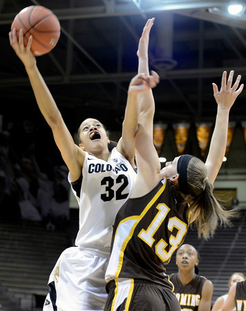 """University of Colorado's Arielle Roberson takes a shot over Ashley Sickles during a game against the University of Wyoming on Wednesday, Nov. 28, at the Coors Event Center on the CU campus in Boulder. For more photos of the game go to  <a href=""""http://www.dailycamera.com"""">http://www.dailycamera.com</a><br /> Jeremy Papasso/ Camera"""