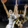 "University of Colorado's Arielle Roberson takes a shot over Ashley Sickles during a game against the University of Wyoming on Wednesday, Nov. 28, at the Coors Event Center on the CU campus in Boulder. For more photos of the game go to  <a href=""http://www.dailycamera.com"">http://www.dailycamera.com</a><br /> Jeremy Papasso/ Camera"