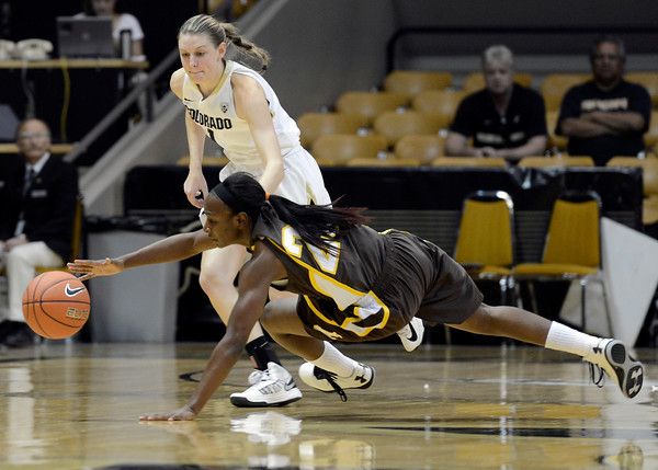 """University of Wyoming's Chelan Landry dives for a loose ball in front of Lexy Kresl during a game against the University of Colorado on Wednesday, Nov. 28, at the Coors Event Center on the CU campus in Boulder. For more photos of the game go to  <a href=""""http://www.dailycamera.com"""">http://www.dailycamera.com</a><br /> Jeremy Papasso/ Camera"""