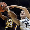 """University of Colorado's Meagan Malcolm-Peck fights for a rebound with Chaundra Sewell during a game against the University of Wyoming on Wednesday, Nov. 28, at the Coors Event Center on the CU campus in Boulder. For more photos of the game go to  <a href=""""http://www.dailycamera.com"""">http://www.dailycamera.com</a><br /> Jeremy Papasso/ Camera"""