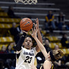 "University of Colorado's Chucky Jeffery takes a shot over Fallon Lewis during a game against the University of Wyoming on Wednesday, Nov. 28, at the Coors Event Center on the CU campus in Boulder. For more photos of the game go to  <a href=""http://www.dailycamera.com"">http://www.dailycamera.com</a><br /> Jeremy Papasso/ Camera"