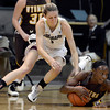 """University of Colorado's Lexy Kresl fights for a loose ball with Chelan Landry during a game against the University of Wyoming on Wednesday, Nov. 28, at the Coors Event Center on the CU campus in Boulder. For more photos of the game go to  <a href=""""http://www.dailycamera.com"""">http://www.dailycamera.com</a><br /> Jeremy Papasso/ Camera"""
