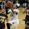 """University of Colorado's Chucky Jeffery goes for a layup over Marquelle Dent, No. 10, during a game against the University of Wyoming on Wednesday, Nov. 28, at the Coors Event Center on the CU campus in Boulder. For more photos of the game go to  <a href=""""http://www.dailycamera.com"""">http://www.dailycamera.com</a><br /> Jeremy Papasso/ Camera"""