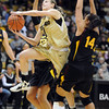 Lexy Kresl of Colorado, drives between Alex Earl, left, and Adrianne Thomas of Arizona State during the first half of the February 11, 2012 game in Boulder.<br /> <br /> February 11, 2012 / Cliff Grassmick