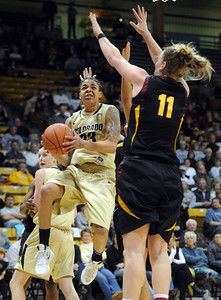 Chucky Jeffery of Colorado double pumps Kali Bennett of Arizona State during the first half of the February 11, 2012 game in Boulder.  February 11, 2012 / Cliff Grassmick