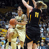 Chucky Jeffery of Colorado double pumps Kali Bennett of Arizona State during the first half of the February 11, 2012 game in Boulder.<br /> <br /> February 11, 2012 / Cliff Grassmick