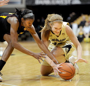Kimberly Brandon, left, of Arizona State, and Rachel Hargis of Colorado, go to the floor to get a loose ball during the first half of the February 11, 2012 game in Boulder.  February 11, 2012 / Cliff Grassmick
