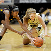 Kimberly Brandon, left, of Arizona State, and Rachel Hargis of Colorado, go to the floor to get a loose ball during the first half of the February 11, 2012 game in Boulder.<br /> <br /> February 11, 2012 / Cliff Grassmick