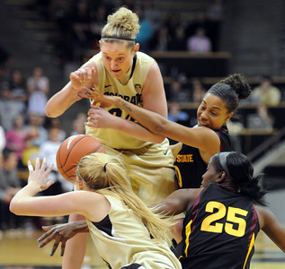 Jen Reese , left facing, of Colorado, and Olivia Major of Arizona State, struggle for the ball during the first half of the February 11, 2012 game in Boulder. February 11, 2012 / Cliff Grassmick
