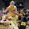 Jen Reese , left facing, of Colorado, and Olivia Major of Arizona State, struggle for the ball during the first half of the February 11, 2012 game in Boulder.<br /> February 11, 2012 / Cliff Grassmick