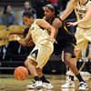 "Brittany Wilson of CU gets a steal from Kimberly Brandon of ASU<br /> during the first half of the February 11, 2012 game in Boulder.<br /> For more photos of the game, go to  <a href=""http://www.dailycamera.com"">http://www.dailycamera.com</a>.<br /> February 11, 2012 / Cliff Grassmick"