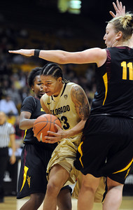 Chucky Jeffery of CU sneaks between Deja Mann, left, and Kali Bennett, both of ASU during the first half of the February 11, 2012 game in Boulder. For more photos of the game, go to www.dailycamera.com. February 11, 2012 / Cliff Grassmick