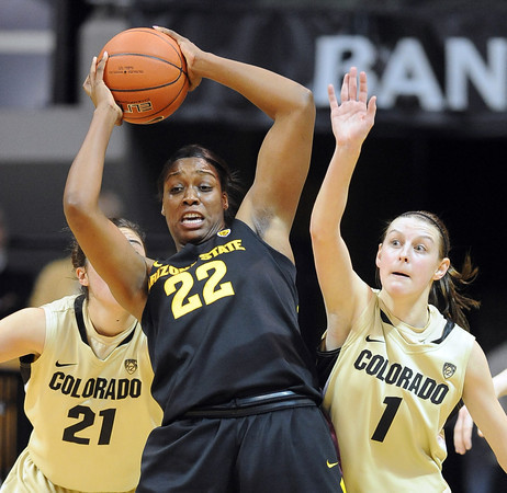 Janae Fulcher (22) of Arizona State, tries to keep the ball away from Lexy Kresl of Colorado during the first half of the February 11, 2012 game in Boulder.<br /> February 11, 2012 / Cliff Grassmick