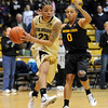 "Chucky Jeffery of CU drives past Olivia Major of ASU<br /> during the first half of the February 11, 2012 game in Boulder.<br /> For more photos of the game, go to  <a href=""http://www.dailycamera.com"">http://www.dailycamera.com</a>.<br /> February 11, 2012 / Cliff Grassmick"