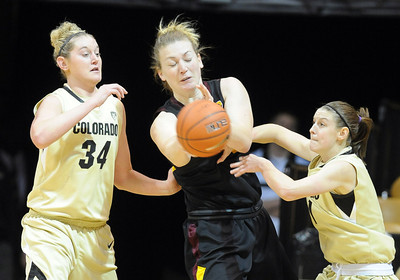 Kali Bennett, center, of Arizona State, gets doubled by Jen Reese, left, and Lexy Kresl, both of Colorado, during the first half of the February 11, 2012 game in Boulder. For more photos of the game, go to www.dailycamera.com. February 11, 2012 / Cliff Grassmick