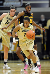 Brittany Wilson of CU gets a steal from Kimberly Brandon of ASU during the first half of the February 11, 2012 game in Boulder. For more photos of the game, go to www.dailycamera.com. February 11, 2012 / Cliff Grassmick