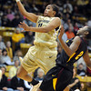 "Brittany Wilson of CU drive past Micaela Pickens of ASU<br /> during the first half of the February 11, 2012 game in Boulder.<br /> For more photos of the game, go to  <a href=""http://www.dailycamera.com"">http://www.dailycamera.com</a>.<br /> February 11, 2012 / Cliff Grassmick"