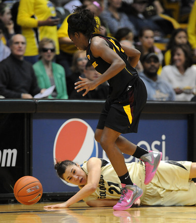 "Jasmine Sborov, bottom of CU, tries to get a steal from Promise Amukamara of ASU during the first half of the February 11, 2012 game in Boulder.<br /> For more photos of the game, go to  <a href=""http://www.dailycamera.com"">http://www.dailycamera.com</a>.<br /> February 11, 2012 / Cliff Grassmick"