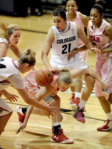 Rachel Messer, center, of Utah loses the ball as Julie Seabrook, Jen Reese, and Jasmine Sborov (21) all of Colorado,  close in during the second half of the February 18, 2012 game in Boulder. For more photos of the game, go to www.dailycamera.com. February 18, 2012 / Cliff Grassmick