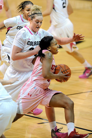 Janita Badon of Utah, drives past Jenn Reese of Colorado<br /> during the first half of the February 18, 2012 game in Boulder.<br /> February 18, 2012 / Cliff Grassmick