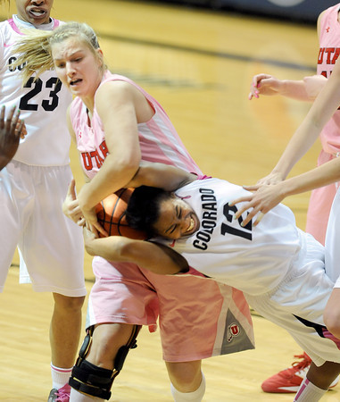 """Taryn Wicijowski, left, of Utah, rips the ball from Ashley of Colorado,<br /> during the second half of the February 18, 2012 game in Boulder.<br /> For more photos of the game, go to  <a href=""""http://www.dailycamera.com"""">http://www.dailycamera.com</a>.<br /> February 18, 2012 / Cliff Grassmick"""