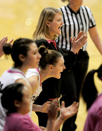 """CU coach, Linda Lappe, top, applauds a good play<br /> during the second half of the February 18, 2012 game in Boulder.<br /> For more photos of the game, go to  <a href=""""http://www.dailycamera.com"""">http://www.dailycamera.com</a>.<br /> February 18, 2012 / Cliff Grassmick"""