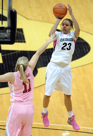 Chucky Jeffery of Colorado takes a jumper over Taryn Wicijowski of Utah during the first half of the February 18, 2012 game in Boulder.<br /> February 18, 2012 / Cliff Grassmick