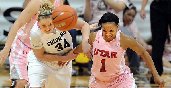 Jenn Reese, left, of Colorado, and Janita Badon of Utah, run down a loose ball during the first half of the February 18, 2012 game in Boulder. February 18, 2012 / Cliff Grassmick