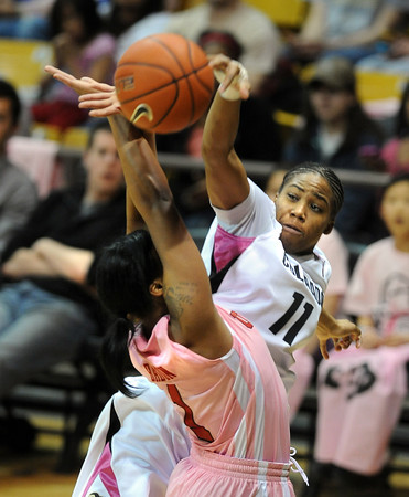 """Brittany Wilson of CU knocks the ball from Janita Badon of Utah<br /> during the second half of the February 18, 2012 game in Boulder.<br /> For more photos of the game, go to  <a href=""""http://www.dailycamera.com"""">http://www.dailycamera.com</a>.<br /> February 18, 2012 / Cliff Grassmick"""
