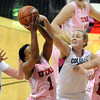 """Janita Badon (1) of Utah gets a rebound from Jen Reese, left, and Julie Seabrook, both of Colorado. Michelle Plouffe  of Utah is on the right.<br /> during the first half of the February 18, 2012 game in Boulder.<br /> For more photos of the game, go to  <a href=""""http://www.dailycamera.com"""">http://www.dailycamera.com</a>.<br /> February 18, 2012 / Cliff Grassmick"""