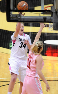 Jen Reese of Colorado puts up a shot over Taryn Wicijowski of Utah during the first half of the February 18, 2012 game in Boulder. For more photos of the game, go to www.dailycamera.com. February 18, 2012 / Cliff Grassmick