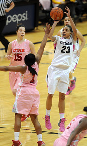 Chucky Jeffery of CU puts up a sht over Janita Badon of Utah during the first half of the February 18, 2012 game in Boulder. For more photos of the game, go to www.dailycamera.com. February 18, 2012 / Cliff Grassmick