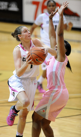 """Lexy Kresl of CU drives on Janita Badon of Utah<br /> during the second half of the February 18, 2012 game in Boulder.<br /> For more photos of the game, go to  <a href=""""http://www.dailycamera.com"""">http://www.dailycamera.com</a>.<br /> February 18, 2012 / Cliff Grassmick"""