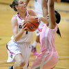 "Lexy Kresl of CU drives on Janita Badon of Utah<br /> during the second half of the February 18, 2012 game in Boulder.<br /> For more photos of the game, go to  <a href=""http://www.dailycamera.com"">http://www.dailycamera.com</a>.<br /> February 18, 2012 / Cliff Grassmick"