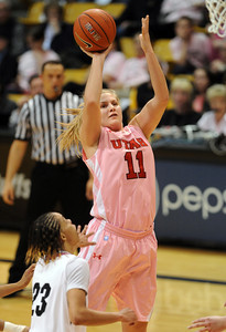 Taryn Wicijowski, of Utah, puts up a shot on Chucky Jeffery of Colorado during the first half of the February 18, 2012 game in Boulder. February 18, 2012 / Cliff Grassmick