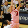 Taryn Wicijowski, of Utah, puts up a shot on Chucky Jeffery of Colorado during the first half of the February 18, 2012 game in Boulder.<br /> February 18, 2012 / Cliff Grassmick