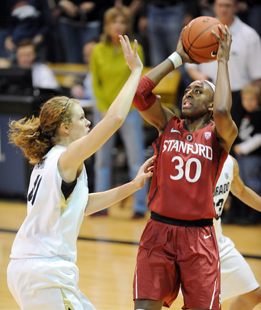 "Nnemkadi Ogwumike of Stanford shoots over Rachel Hargis ofCU in the first half.<br /> For more photos of the game, go to  <a href=""http://www.dailycamera.com"">http://www.dailycamera.com</a>.<br /> January 14, 2012 / Cliff Grassmick"
